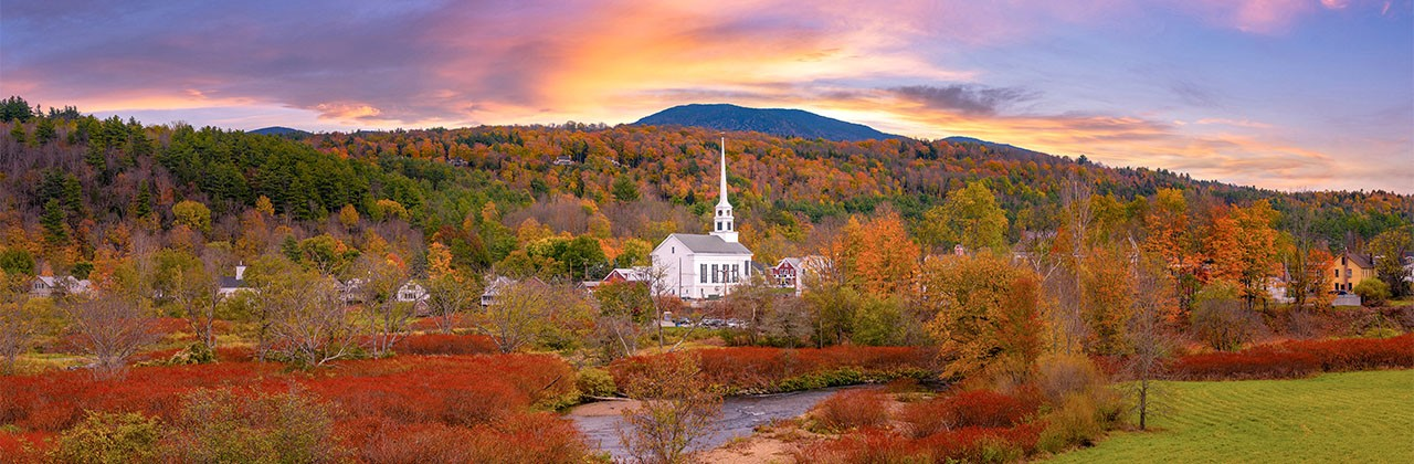 Panorama of Stowe Church in Vermont surrounded by the beautiful fall foliage