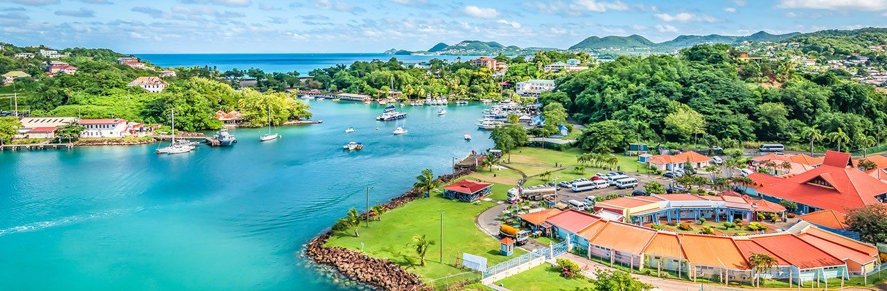 Aerial view of a waterfront and marina in Saint Lucia