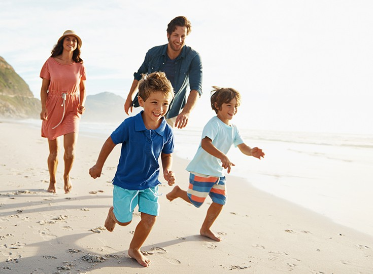 Family running on beach