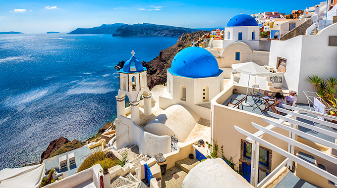 The iconic blue domes of Santorini, Greece.