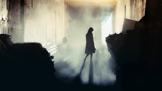 A ghostly shadow in a foggy room.