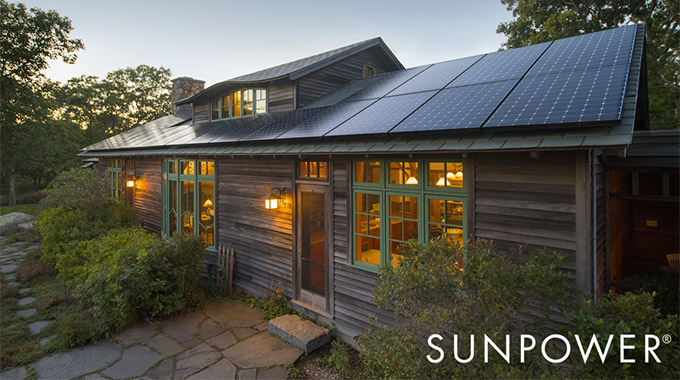 A home with solar panels on the roof in the evening