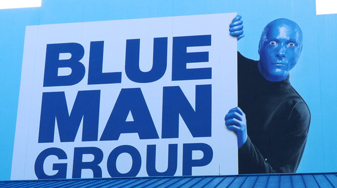 A Blue Man Group sign