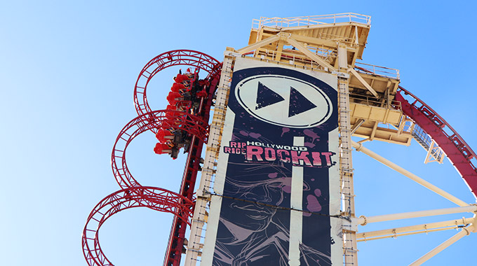 A Hollywood Rip Ride Rockit roller coaster climbs the lift tower at Universal Orlando Resort