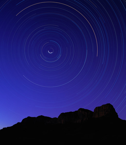 A timelapse image of stars over the Guadalupe Mountains