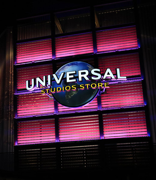 Front of the Universal Orlando Resort store at CityWalk lit up pink