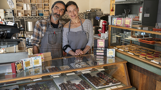 Owners Javi Abad and Debi Vincent share sweet treats at their store in Taos. | Photo by Geraint Smith