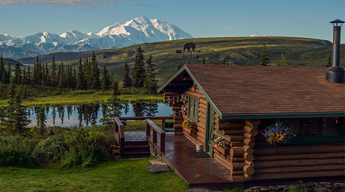 At its most reflective, Nugget Pond turns Camp Denali's legendary views into an even greater spectacle. But you may spot more than peaks and pines on the surface: The (very) occasional moose has been known to swim here. | Photo courtesy Camp Denali