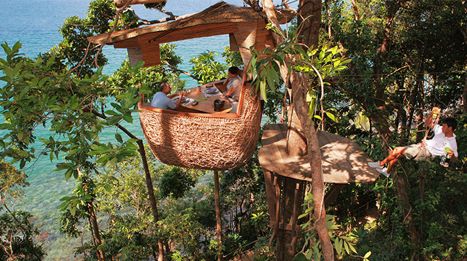 Why yes, that is a zip-lining waiter. And if you book his services at Soneva Kiri, he'll deliver locally sourced delicacies to your bamboo tree pod in an ancient, seaside rain forest. | Photo courtesy Soneva Kiri