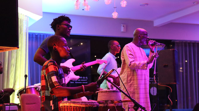 Senegalese legend Omar Pene (far right) and his band take the stage in Dakar.