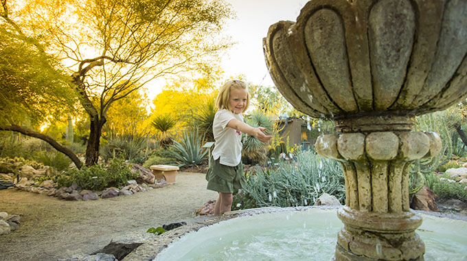 A child plays at a fountain at the Tucson Botanical Gardens. | Photo by Dominic Bonuccelli/Tucson Botanical Gardens
