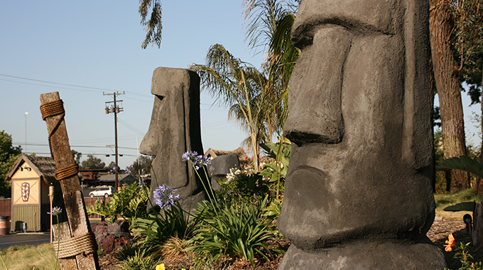 The Mission Tiki Drive-In Theatre is decorated with Rapa Nui statues reminiscent of those found on Easter Island. | Photo by  David Vonderlinn / Courtesy Mission Tiki Drive-In Theatre
