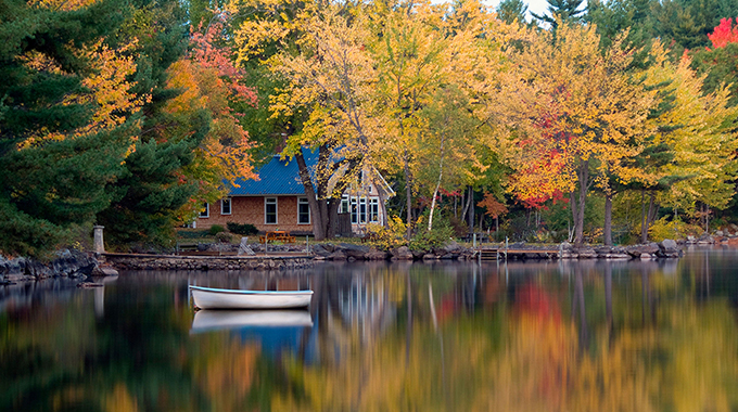 A boat is moored on Long Lake, near Bridgton, Maine, a leaf-peeping area recommended by Sarah Long, a TV meterologist.