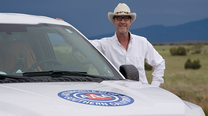 AAA Field Cartographer Shane Henry with his Mapping Unit Truck, a Ford F-150.