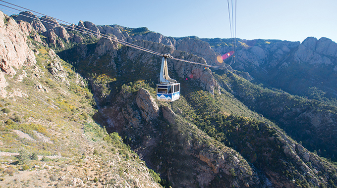The aerial Sandia Peak Tramway stretches from the northeast edge of Albuquerque to Sandia Peak on the ridgeline of the Sandia Mountains. | Photo by Steve Larese