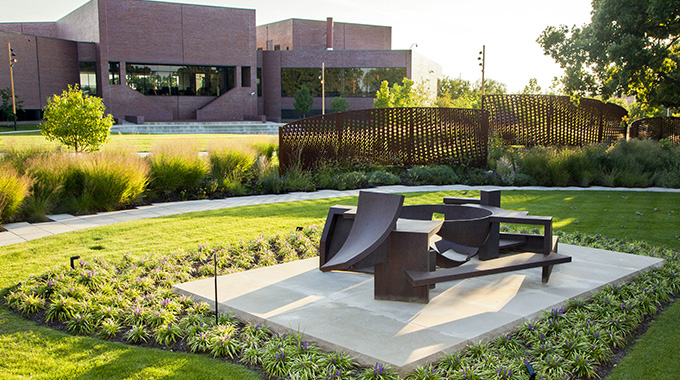 "Artist Isaac Witkin's brushed steel ""Yantra,"" in the foreground, is one of 13 fascinating sculptures that surround the Wichita Art Museum. 