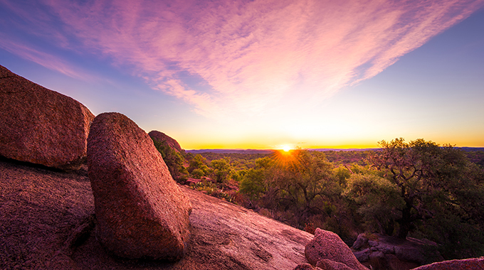 Watch the sunset with your sweetheart at the Enchanted Rock State Natural Area. | Photo by Adobe Stock Photo