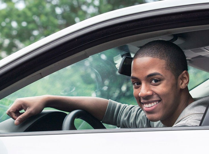Young man in car learning to drive