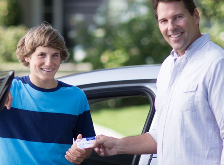 Father and son driving school with AAA membership