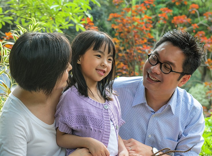 Asian family at park