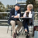 Older couple having coffee outside