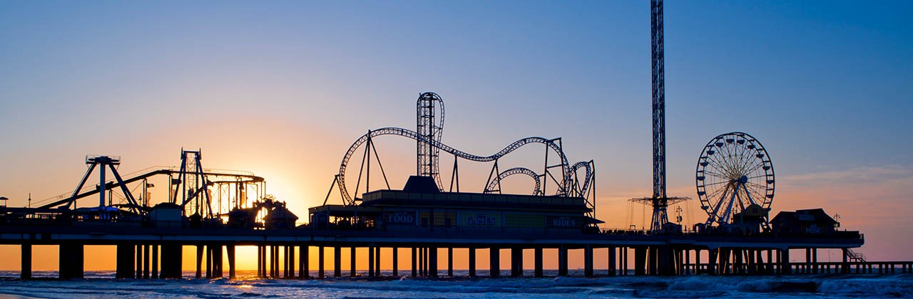 Galveston Historic Pleasure Pier offers games, rides and roller coasters.