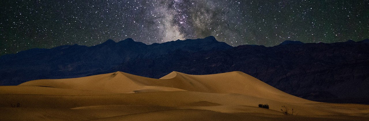 Death Valley sand dunes at night beneath the stars of the Milky Way