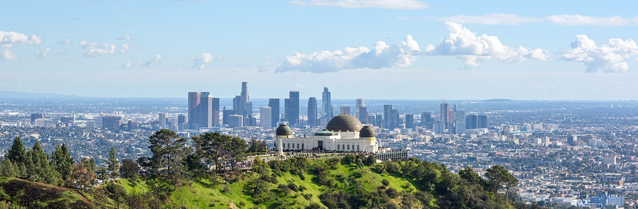 A view of the Griffith Observatory and downtown Los Angeles from Griffith Park.