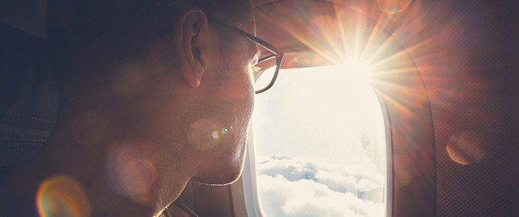 Man looking out of plane window