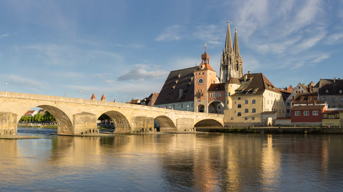 An old stone bridge in Regensburg, Germany