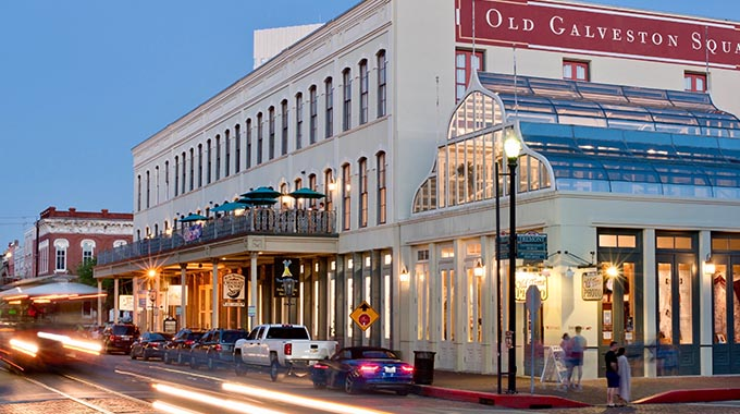 Streaks of trolley headlights illuminate the shops, galleries and restaurants at Old Galveston Square. |